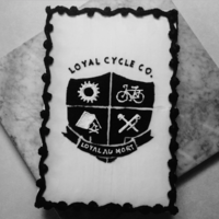 Loyal Cycling Sheet Cake Our local bike shop celebrated their annual fall community bike ride by introducing their new logo with this cake. I hand stenciled the...