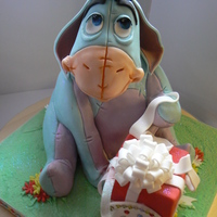 Eeyore For A 30Th Birthday Celebration Chocolate cake with chocolate ganache and then covered in fondant.