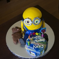 "Minion Bob With Tim Birthday Cake I made this cake for my daughter's 9th birthday. She wanted Bob the Minion with his teddy bear Tim. The minion is half of a 6""..."