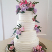 Buttercream Stripes The flowers on this cake remind me of butterflies...which was perfect for her garden themed reception hall. I used a edging tool to stripe...