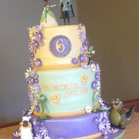 Princess & The Frog Cake Princess & the Frog cake. All edible except plastic character figurines.