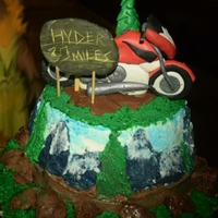Mountain Cake Bike buttercream painted cake for a mountaineers who loves his red bike