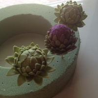 Gumpaste Artichokes  First time making artichokes. Two closed, one blossomed (artichoke blossoms are simply stunning in real life...the purple practically glows...