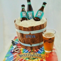 "Sweetwater 420 Beer Bucket Cake Isomalt bottles, rock candy ice, fondant slats; 4 layers of 9"" cake, carved at the bottom and filled with buttercream and frosted with..."