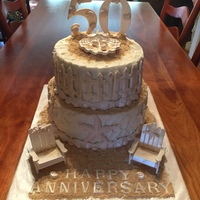 "50Th Anniversary Cake  Two Tier, 8"" Carrot Cake and 10"" Vanilla Cake. Decorated in Beach, Sea Shell Theme. All shells and Chairs made of Gumpaste...."