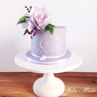 Lilac Brush Embroidery Cake A chocolate cake with a mocha buttercream and caramel buttercream, covered in ganache.Lilac fondant with brush embroidery lace and sugar...