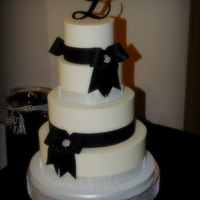 Black Tie Affair This four tiered wedding cake consisted of vanilla, chocolate, strawberry and carrot cakes, all iced in vanilla buttercream, with black...