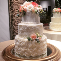Buttercream Pearls And Roses This bride chose buttercream roses with pearl centers for her bottom tier, a stacked pearl tier for the middle layer and a top tier with a...