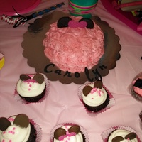 Minnie Mouse Cake Chocolate cake with strawberry icing. I used fudge covered oreos for the ears and printed out the lettering on the cricut and glued it. (I...