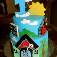 Thomas The Train Cake Red velvet with cream cheese filling and chocolate cake with cookies and cream fillingFondant accents and gumpaste number 1 and sun