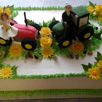 Tractor Theme Cake A full slab cake 1/2 choc, 1/2 vanilla. Cake topper made of rice crisp and fondant. A country wedding theme cake.