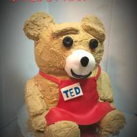 Ted Cake Ted the Bear in his grocery worker apron.