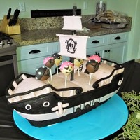 Pirate Ship Birthday Cake This is a pirate ship cake for a 6 year old girls birthday. It was done in black and pink fondant, although the picture looks a bit beige....