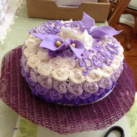 Purple Ombré Birthday Buttercream Ombré rosettes with purple fondant Cala Lilies