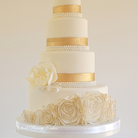 Rosette Ruffles And Gold   Brushed gold bands, rosettes ruffles, and over-sized peony roses.
