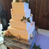 4 Tier Buttercream Wedding Cake With Fresh Flowers Clean straight sharp edges are not easy with buttercream!