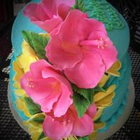 Cascading Hibiscus Cake with a tropical theme. Cascading Hibiscus flowers.