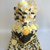 My Parents Golden Anniversary Cake I wanted to pay tribute to my parents celebrating 50 happy years. Mum loves flowers and I also wanted to use traditional cake pillars to...