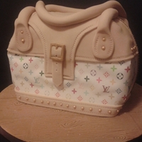My First Handbag Cake My first handbag cake. I was asked to make a handbag cake for my husband colleagues wife. I was quite interested at having ago till I found...