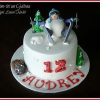 Skier Cake   For a young ski lover. With her little poodle on the left side ;)
