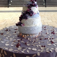 Wine And Roses Wedding Cake By Queen Anne's Lace Cakes Lavender Sugar Roses and real grapes adorn this very Italian Wedding Cake. The bottom tier was a Golden Butter Cake filled with Milk...