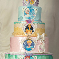 Disney Princess  This is a five tiers cake with all her favorite princesses!! I used a lot of wafer paper to add a bit of lightness with all these colors...