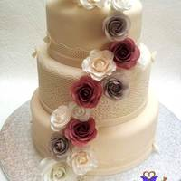 "Ivory And Dusky Pink Rose Wedding Cake Top cake is fruit cake, middle is chocolate sponge and bottom is vanilla sponge. 6"", 8"" and 10"". Ivory fondant and lace..."