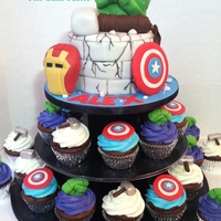 Superhero Chocolate cake and cupcakes with Vanilla Buttercream, decorated in LMF. I need to give a shout out to the designer that I borrowed the...