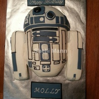 R2D2 Cake This is a buttercream cake with fondant accents. It is a ball cake for head and 8 inch round cakes cut in half and turned on the side for...