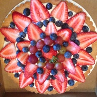 "Fruit Pizza/tart A 9"" cookie tart crust filled with cream cheese frosting and fresh fruit. Thanks for looking!"