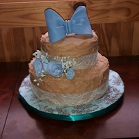 Burlap And Blue Cake Vanilla/almond cake tinted baby blue for a baby shower. Vanilla buttercream colored to match the burlap theme of the shower. Also has...