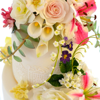 Summer Flower Profusion. Wedding cake with all of my favourite flowers.Lily, roses, lily of the valley, gardenias and hydrangeas.