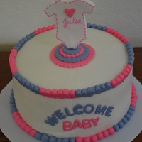 Gender Reveal Cake Blue, pink & white cake decorated for gender reveal - monogrammed onesies