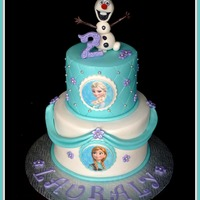 Frozen Cake   Frozen cake with Olaf figure and edible images.