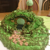 Hobbit Home Cake Made for my grandson. White cake with buttercream icing and a little fondant decor