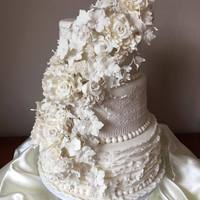 Weddingcake Totally White   White Weddingcake with gumpasteflowers, lace and ruffels.