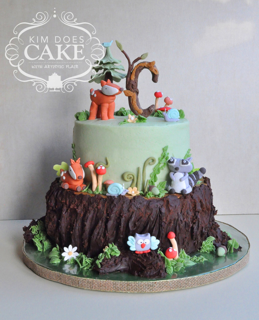 woodland theme baby shower cake with lots of animal figures bottom