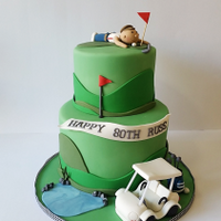 Surprise Golf Themed Cake For An 80Th Birthday Surprise 80th birthday cake for a keen golfer. The design includes and edible golf buggy, golf bag and a golfing man.