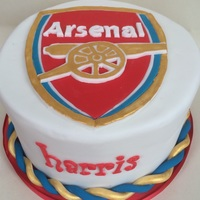 Arsenal Cake 8 inch, 2 layer chocolate cake. With chocolate buttercream filling covered with ganache and fondant