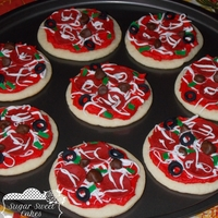 Pizza Cookies 12 sugar cookies decorated like pizza's. Iced in buttercream with fondant decorations. TFL!