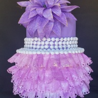 Wedding Cake made the second layer from edible wafer paper looked like ruffle/skirt dress with fantasy wafer paper flowertfl https://www.facebook.com/...