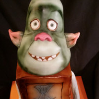Fish The Box Troll Chocolate filled and covered in buttercream with marshmallow fondant cover. Airbrushed to look like a box and the head. Eyes, mouth, ears,...