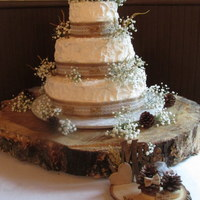 Rustic Wedding Cake All buttercream, with burlap ribbon and baby's breath.