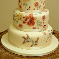 Vintage Themed Hand-Painted Wedding Cake With Birds. Based on the youngest bridesmaids dress.