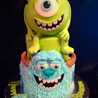 "Monsters Inc. ""Mike"" on top was a Styrofoam ball covered in 50/50 mix of marshmallow fondant and modeling chocolate. His legs and arms were 100..."