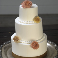Buttercream Anniversary Cake Tiered Buttercream anniversary cake with gumpaste roses.