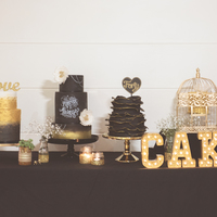 Black And Gold Wedding Cakes  Here's our finished wedding cake table, all edibles made by me! I wouldn't recommend that any bride makes her own cakes, it was...