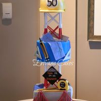 Civil Engineer Cake All the add ons are edible. The separator is made to look like a cell tower