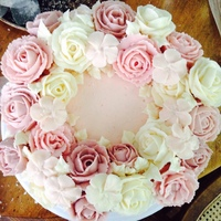 Floral Wreath Cake This is a vanilla cake with freshly whipped cream and raspberry jam for the filling, iced with a strawberry buttercream. The flowers are...