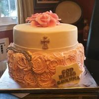 Christening,   The bottom tier covered in buttercream rosettes and top covered in fondant. All decorations made of fondant.